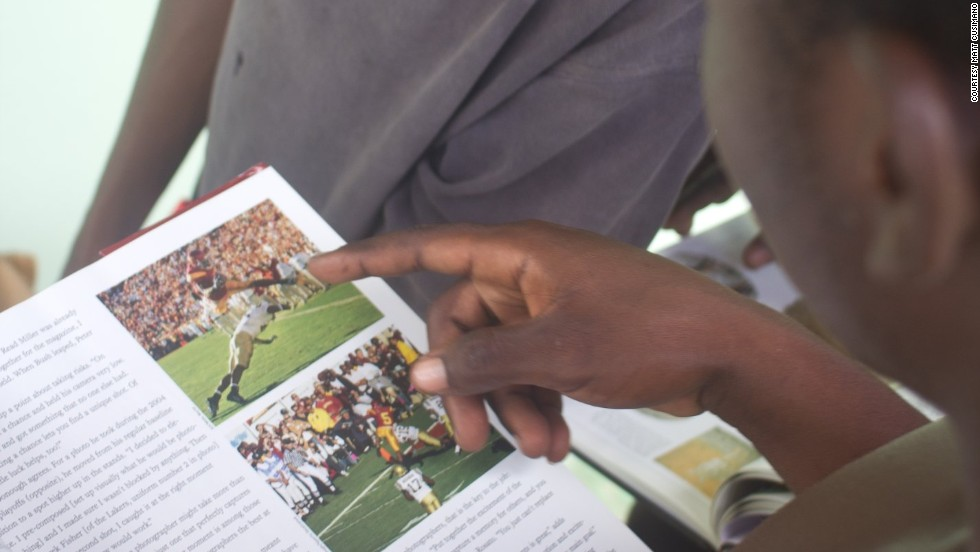 Teenagers were the first to explore the books donated to the Sandvoort library, including this one on college football.