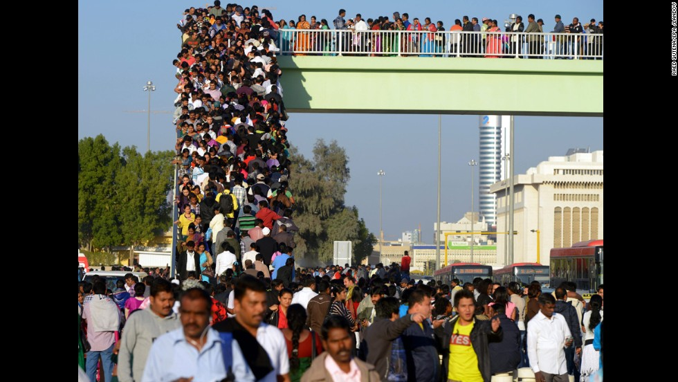 Christians of the East Asian communities in Kuwait take a bridge leading to a complex of churches during Christmas celebrations in Kuwait City, Kuwait.