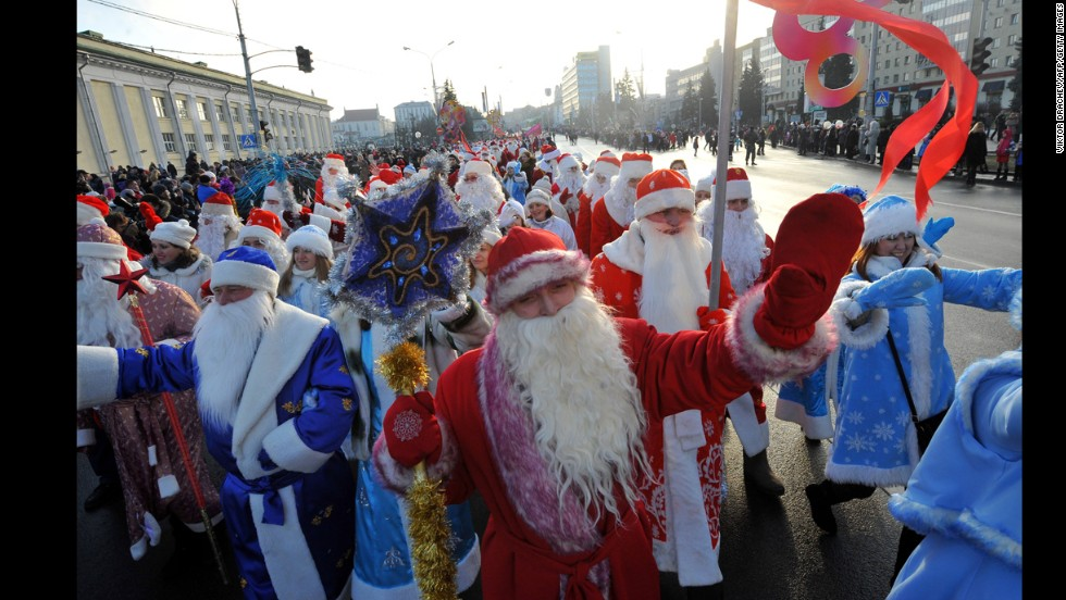People wearing the costumes of Ded Moroz (Grandfather Frost), and Snegurochka (Snow Maiden), parade in Minsk, Belarus.