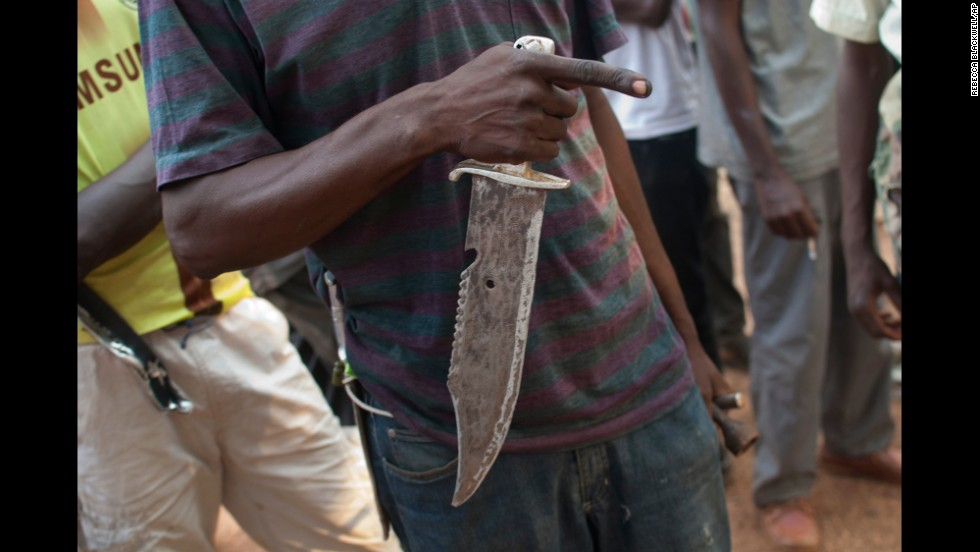 A militiaman holds a knife as he describes a recent attack in Bangui on Tuesday, December 24.