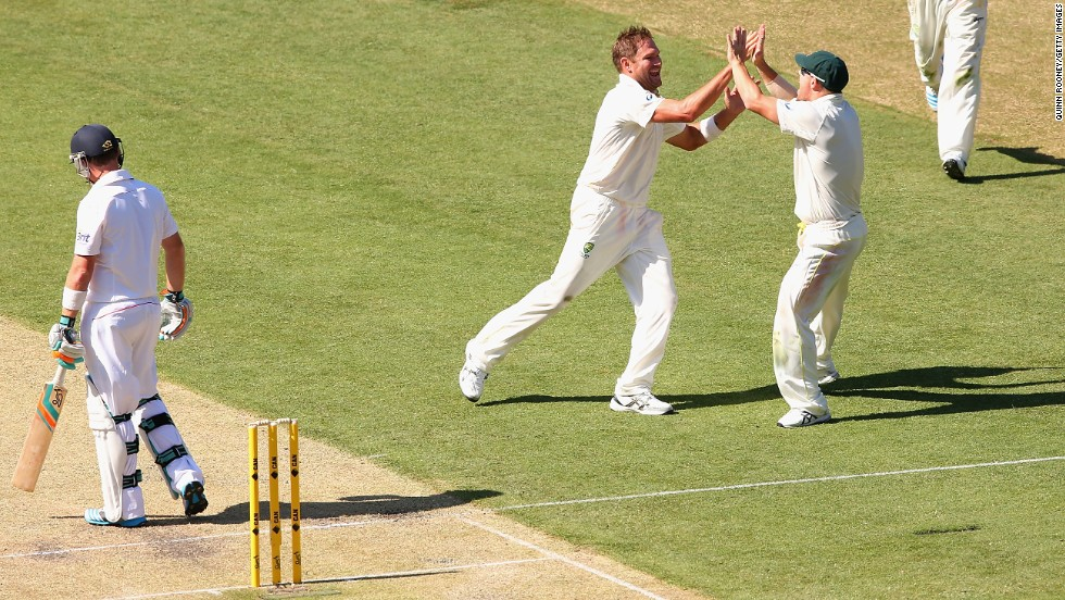 Johnson wasn't the lone Australia bowler to excel. Ryan Harris took two wickets, too. He celebrates with teammate David Warner, far right, after ousting Ian Bell.