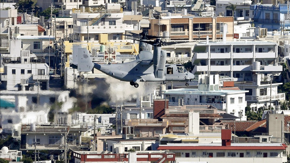 An Osprey tilt-rotor aircraft flies over Ginowan on August 3, heading for the Futenma Air Station for additional deployment. The stagnation of the relocation issue has been a thorn in the side of relations between Tokyo and Washington since 1996, when the two governments agreed on the original plan to move the base.
