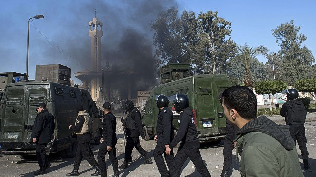 Egyptian riot policemen surround the entrance of al-Azhar university during clashes with students who support the Muslim Brotherhood, in Cairo's eastern Nasr City district on December 27, 2013. At least 148 pro-Islamist protesters were arrested after they rallied in several Egyptian cities, police said, as the authorities vowed to repress demonstrations by the Muslim Brotherhood. AFP PHOTO / KHALED DESOUKIKHALED DESOUKI/AFP/Getty Images