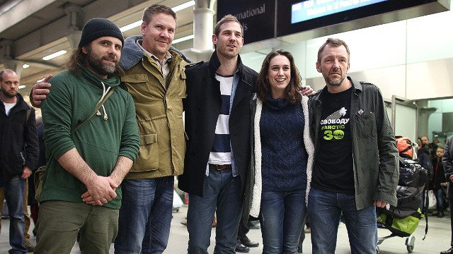 LONDON, ENGLAND - DECEMBER 27: Freed Greenpeace activists (L-R) Iain Rogers, Anthony Perrett, Kieron Bryan, Alexandra Harris and Phil Ball pose for a photograph after arriving at St Pancras railway station on December 27, 2013 in London, England. The activists were released after being granted an amnesty by the Russian authorities. They have spent the last 100 days in prison after being arrested during a protest against oil drilling in the Arctic. (Photo by Peter Macdiarmid/Getty Images)