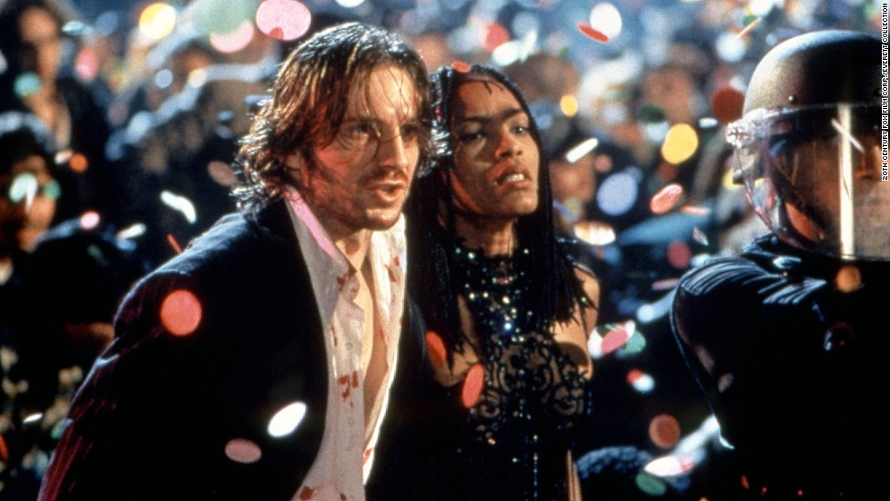 "<strong>""Strange Days"" </strong>--<strong>  </strong>""Cheer up, world's going to end in 10 minutes anyway,"" Tom Sizemore tells his friends during Kathryn Bigelow's sci-fi thriller, which takes place in the last day or so of the 20th century, when everyone was partying like it was 1999 (well, because it was). Black-market dealer Lenny (Ralph Fiennes) and his bodyguard Mace (Angela Bassett) try to solve a rape and murder caught on a tape that was recorded directly from the victim's cerebral cortex. Talk about a new way of experiencing other people's memories. Maybe some other New Year's Eve, this will be how we watch movies -- jacking in."
