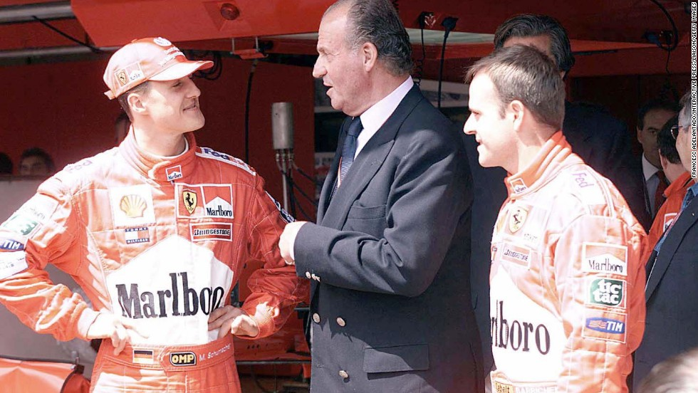 A move to Ferrari in 1996 was to bring more success for Schumacher, seen here meeting King Juan Carlos of Spain in 2001.
