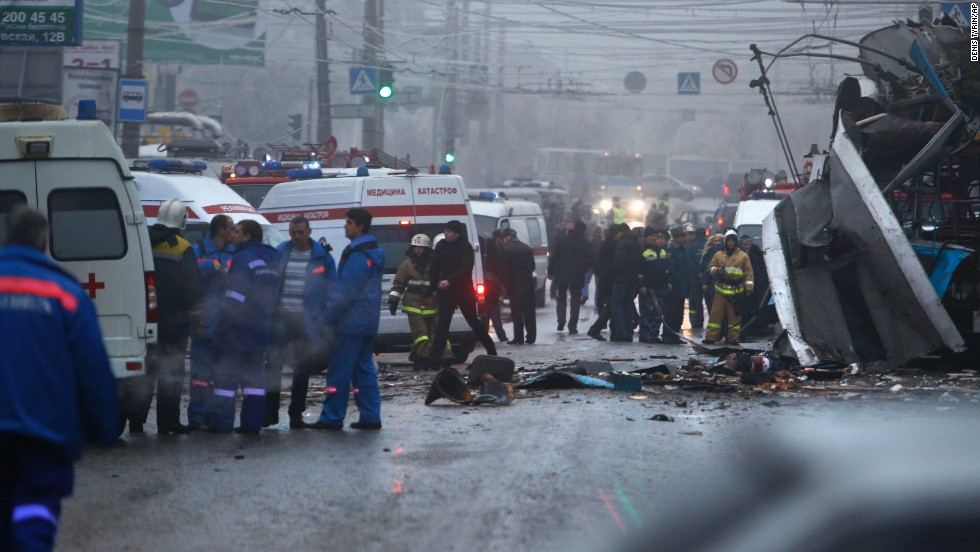 Experts, firefighters and police officers examine the scene of the blast.