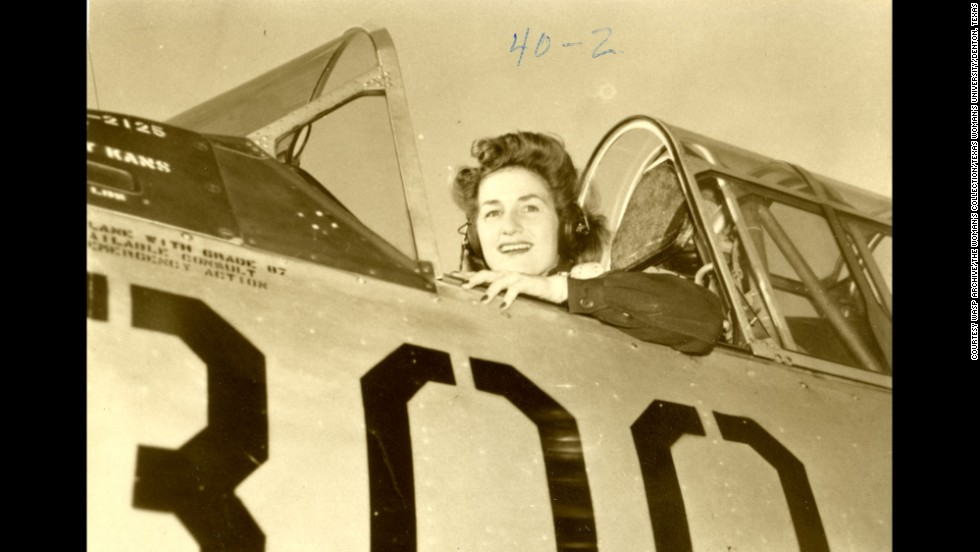 Alma Jacomini in the cockpit of her airplane at Garden City Army Air Base in Kansas.