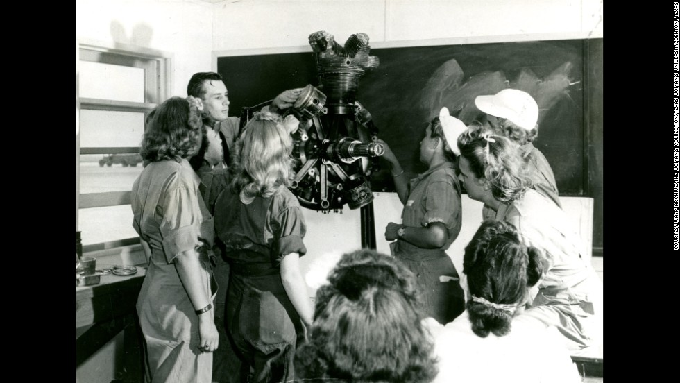 WASPs study in engines class with instructor Mr. Crawford, at Avenger Field, Sweetwater, Texas.<br />
