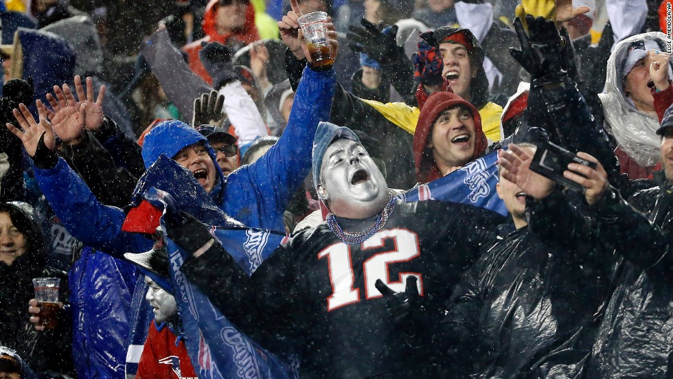 <strong>December 29: </strong>Rain-soaked New England Patriots fans cheer during the third quarter of an NFL football game between the Patriots and the Buffalo Bills.