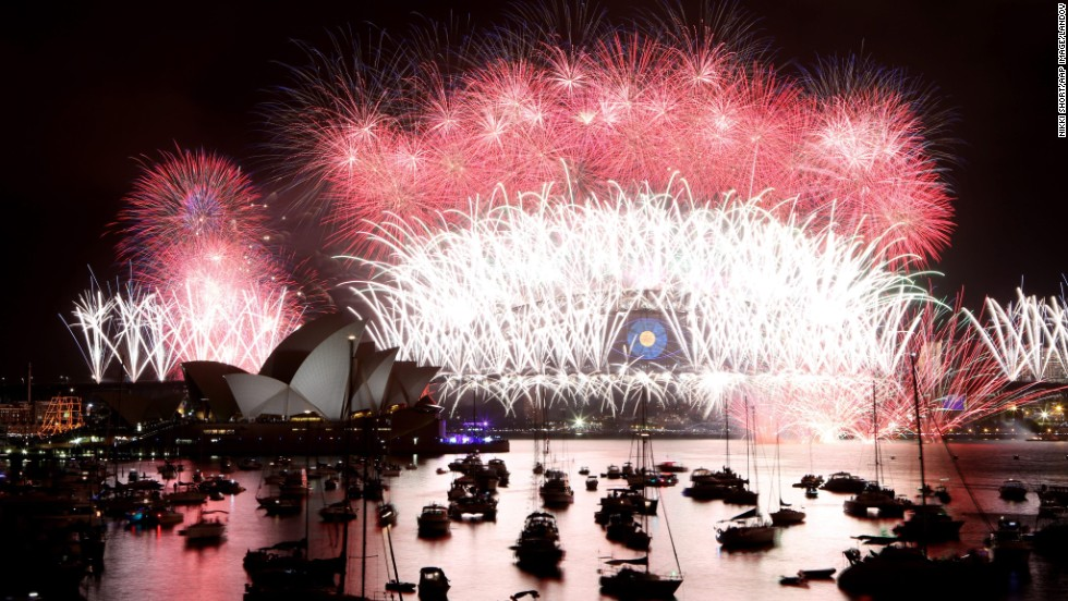Fireworks explode near the Harbor Bridge during New Year's celebrations in Sydney. As the city's spectacular celebration got under way, six people were rescued from a sinking boat on Sydney Harbor, The Sydney Morning Herald reported.