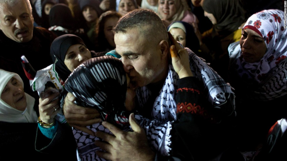 "DECEMBER 31 - RAMALLAH, WEST BANK: A released Palestinian prisoner is embraced by his family, after <a href=""http://cnn.com/2013/12/30/world/meast/israel-palestinian-prisoner-release/index.html?hpt=imi_c1"">Israel freed 26 prisoners in a gesture of goodwill between the two sides</a>. The release was a step aimed at ""resuming the diplomatic process,"" Israeli Prime Minister Benjamin Netanyahu's office said. Many of the prisoners have served sentences of 19-28 years for deadly attacks against Israelis."