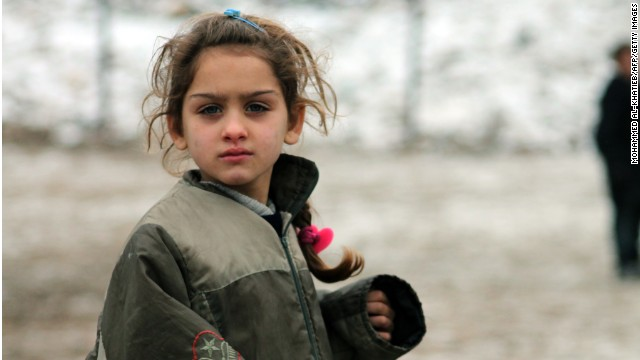 A Syrian girl plays in the city of Aleppo, bombed two days after this photo was taken on December 13.