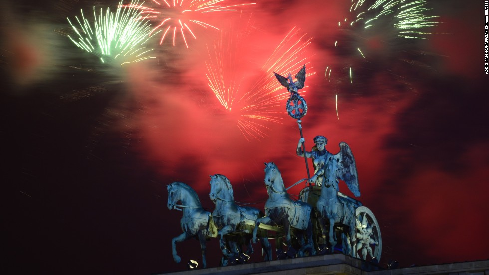 Fireworks explode over the landmark Brandenburg Gate to bring in the new year in Berlin on Wednesday, January 1.