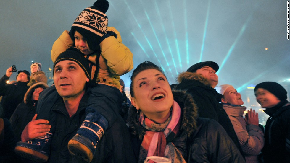 People take part in New Year's celebrations at Independence Square in Kiev, Ukraine.