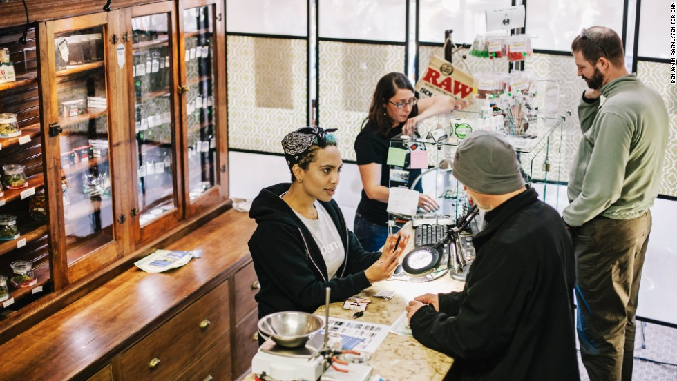 Beej Jackson, left, and Amber Bacca serve customers in Evergreen Apothecary in Denver. In 2012, 55% of Colorado voters said yes to legalizing recreational marijuana.