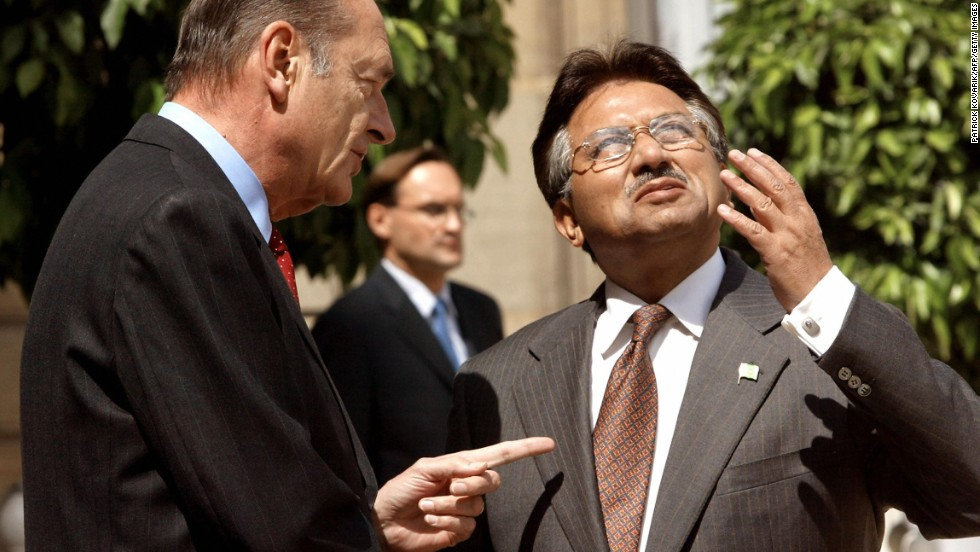 Former French President Jacques Chirac speaks with Musharraf at the Elysee Palace in Paris in 2003.
