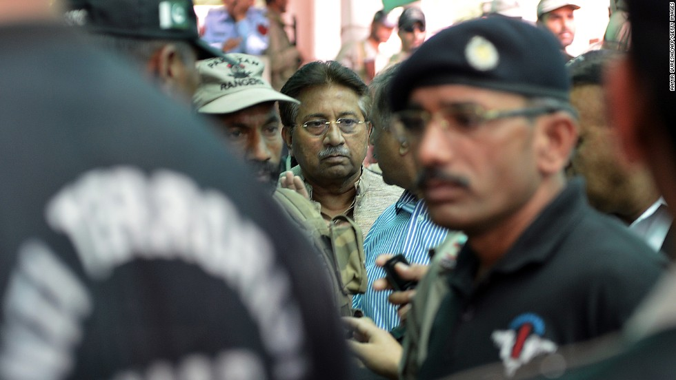 Musharraf is escorted by soldiers as he arrives at an anti-terrorism court in Islamabad on April 20, 2013. A Pakistani court rejected Musharraf's request for a bail extension, and Musharraf was put under house arrest.