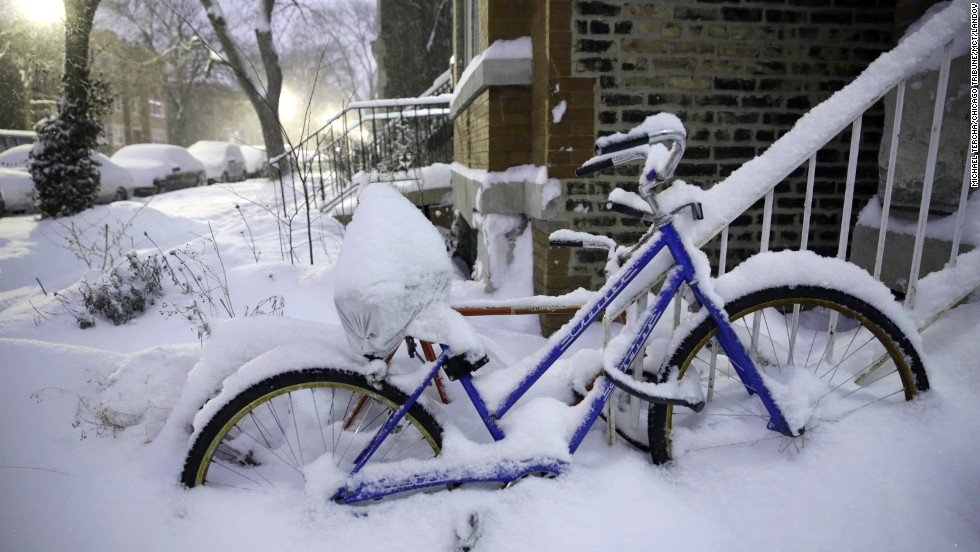 Snow covers bikes along Leavitt Street in Chicago's Wicker Park on January 2.