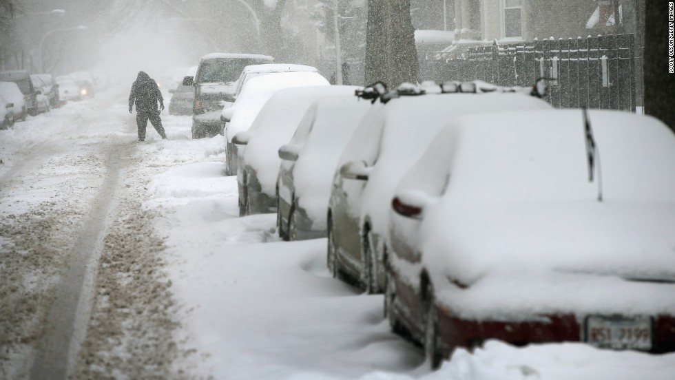 Snow covers cars in Chicago's Humboldt Park neighborhood on January 2.