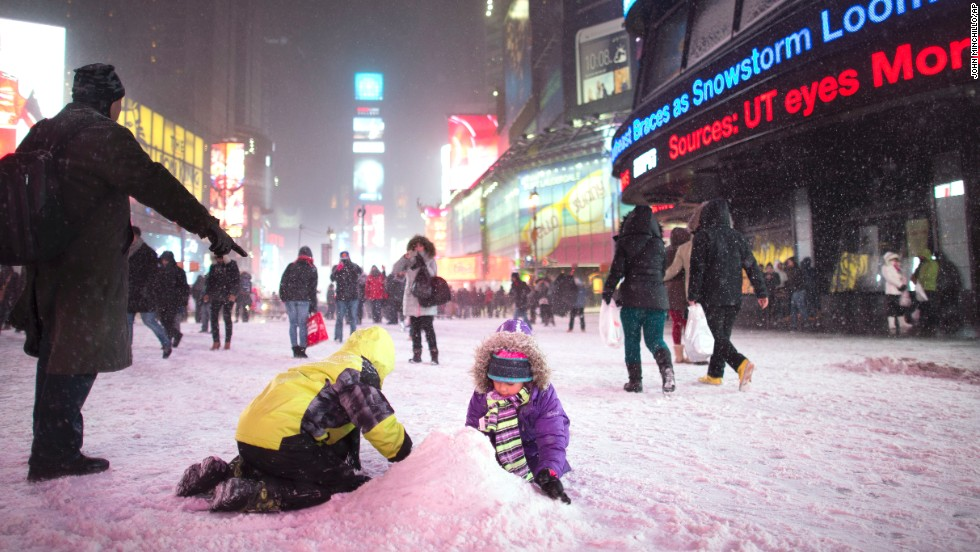 Children make a snow pile in New York's Times Square on January 2.