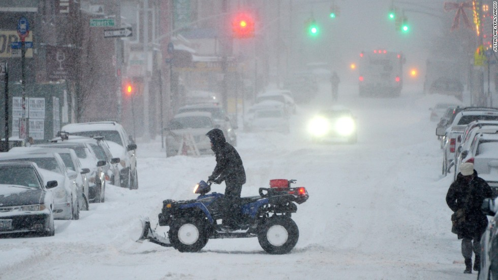 A man rides an all-terrain vehicle through a Brooklyn street on January 3.