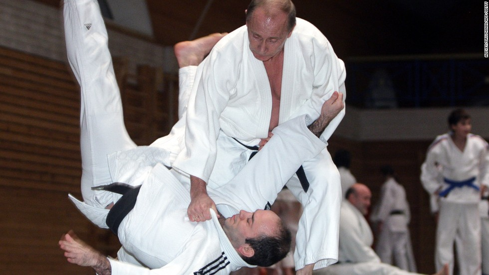 Putin shows off his legendary judo skills on a visit to a center in St Petersburg.