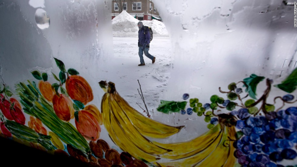 Frost covers the windows at the Morning Glory natural food store in Brunswick, Maine, on January 3.