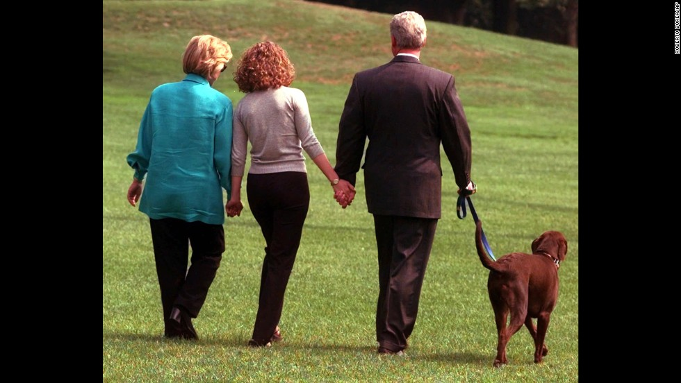 On August 18, 1998, Chelsea Clinton walks with her parents on the White House grounds. The President is walking the family dog, Buddy.