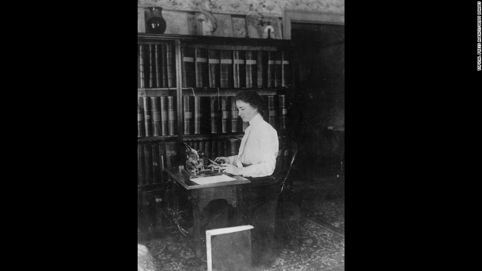 Helen Keller, the blind and deaf author and lecturer, sits at her typewriter in this undated photo.