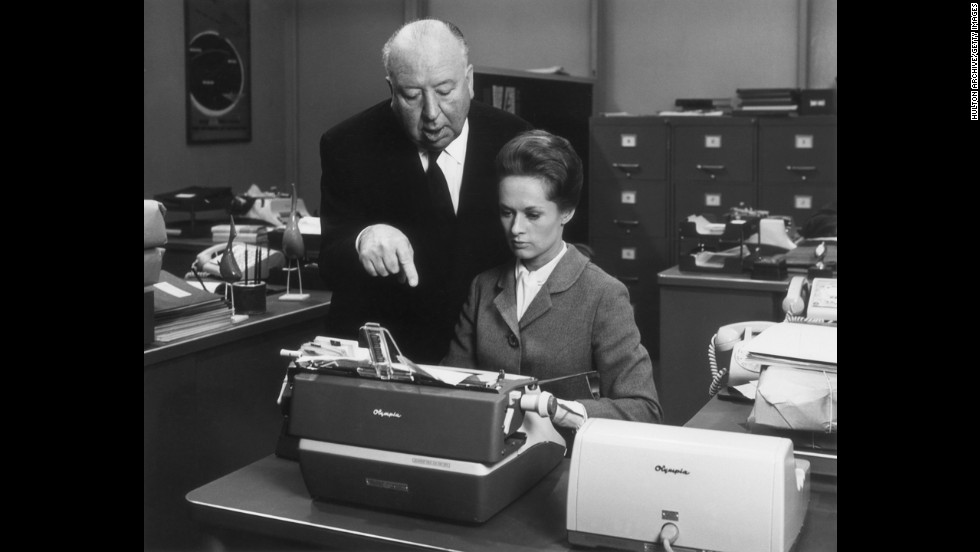 "Alfred Hitchcock, who directed more than 50 films including ""Psycho"" and ""The Birds,"" works with actress Tippi Hedren on the set of his 1964 film ""Marnie."""