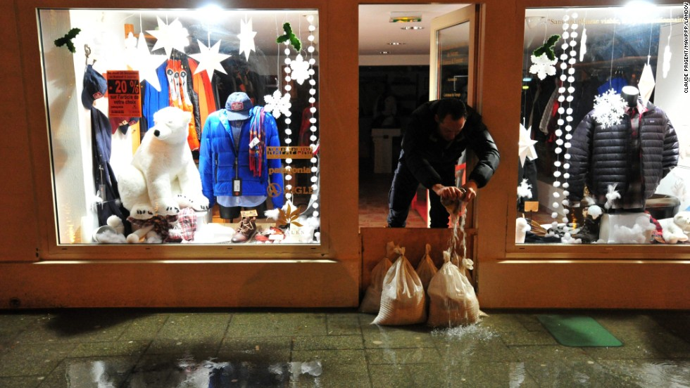 Water is mopped up from a shop in Brittany, France, on January 4.