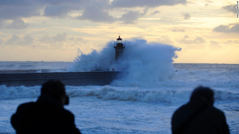 Heavy seas cause waves to crash over a lighthouse at the mouth of the Douro River in Porto, Portugal, on January, 4.