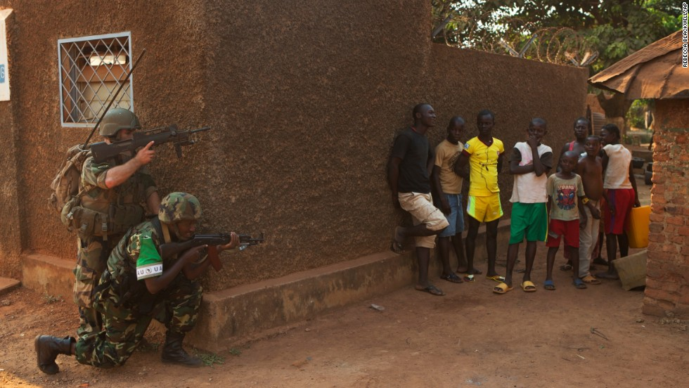 A French soldier and an African Union peacekeeper from Burundi patrol the Galabadja district of Bangui on Saturday, January 4. While insecurity continued to reign in many areas of the city, certain neighborhoods were tentatively reopening and some residents returning, at least during daylight hours.