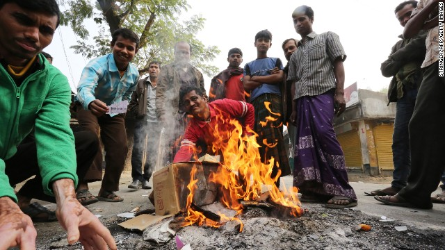 Bangladeshi protestors burn election material at a polling station in the northern town of Bogra on Sunday.