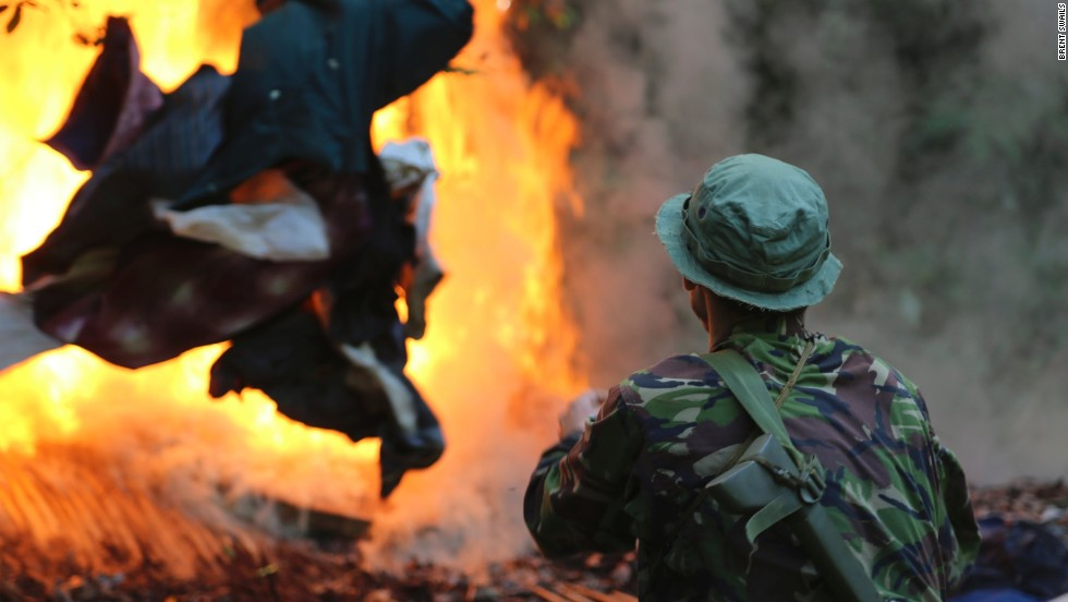 "The head of the unit, Mathieu Eckel Eckel, tosses the poacher's clothing on the blaze. Forty percent of Eckel's men are former poachers themselves. ""They are really motivated to stop the poaching and they know how the poachers work, so it's easy for them to think like them, "" Eckel explains."