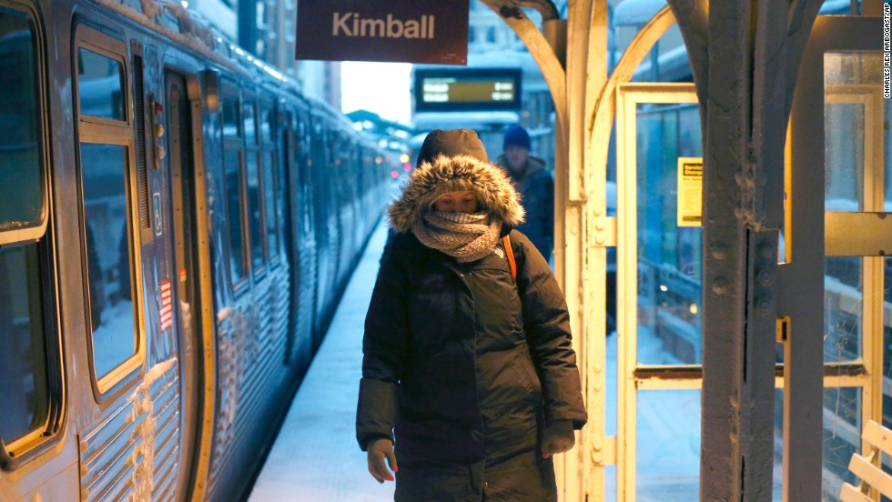 A commuter walks past warming lamps at a Chicago train station on January 6.
