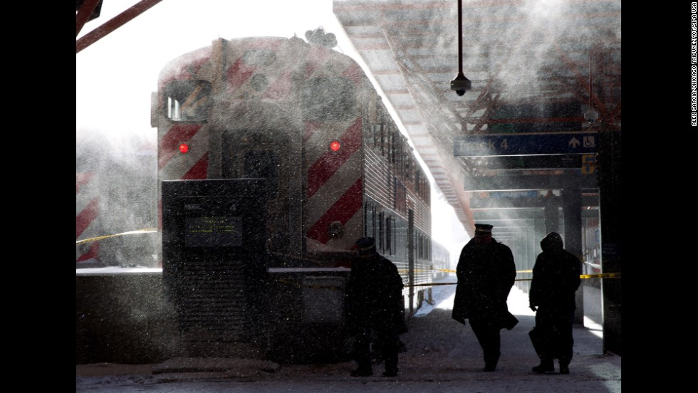 Metra employees in Chicago walk around LaSalle Street Station on January 6.