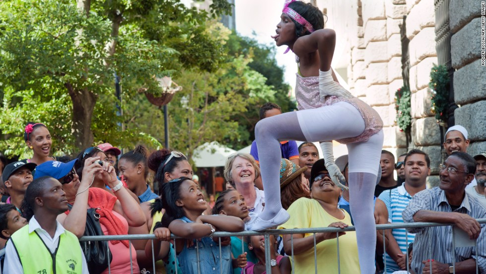Enthusiastic onlookers lined the streets of central Cape Town to cheer performers and take part in the festivities.