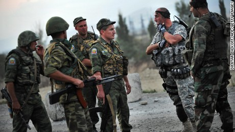 Russian peacekeepers talk with Georgian soldiers near the village of Khurvaleti during the conflict in August 2008.