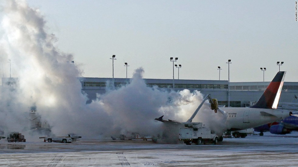 A Delta Air Lines plane is de-iced at Chicago Midway International Airport on January 6.