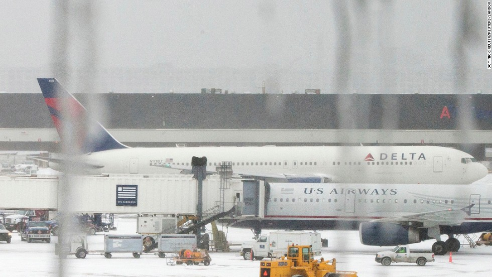 Icicles hang from a window looking onto airplanes at Logan International Airport in Boston on January 2.