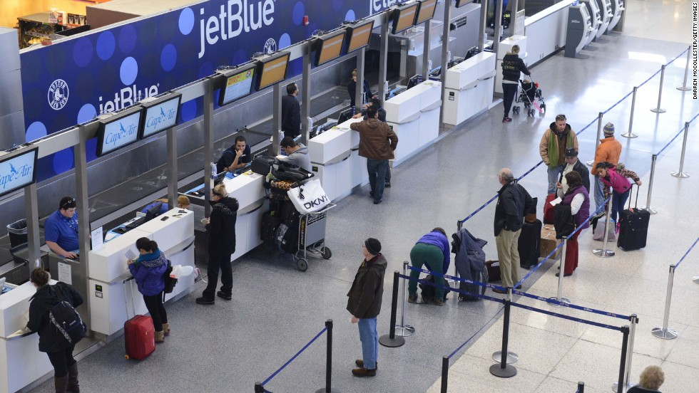 JetBlue passengers in Boston wait for normal flights to resume at Logan International Airport on January 7.