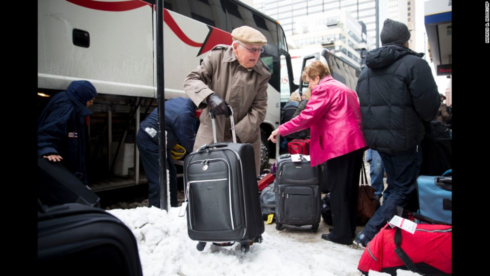 Passengers unload their luggage at Chicago's Union Station after their Amtrak train became stuck in snow drifts on Tuesday, January 7.