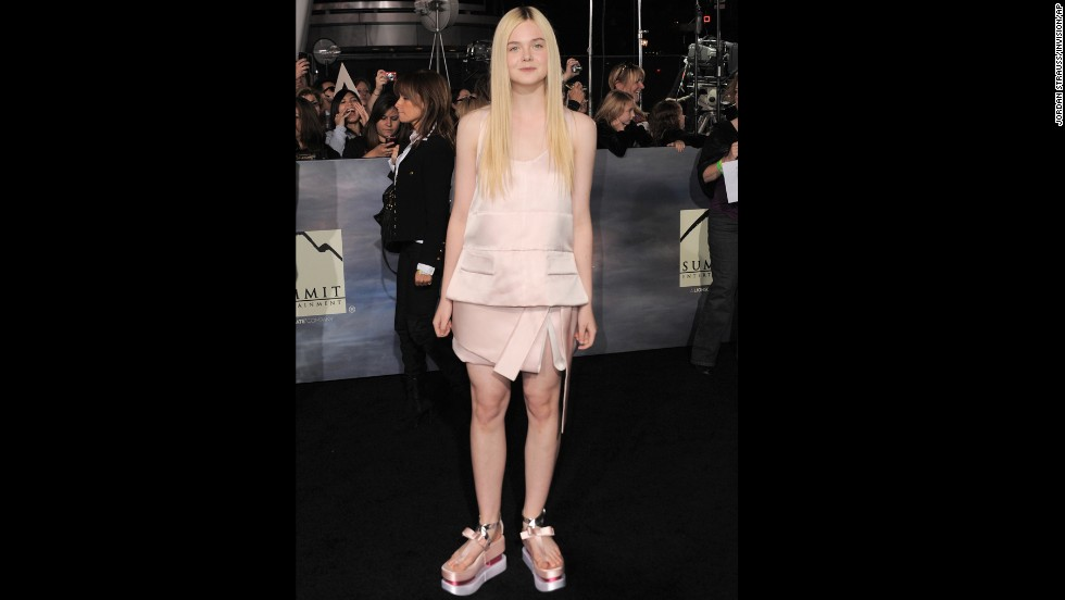 Flatforms, like Elle Fanning's pink satin Prada sandals, will not return to the fashion fray in 2014. Really, have you tried walking in them?