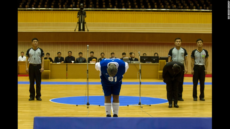 Rodman bows to Kim, seated above in the stands, before the basketball game on January 8.