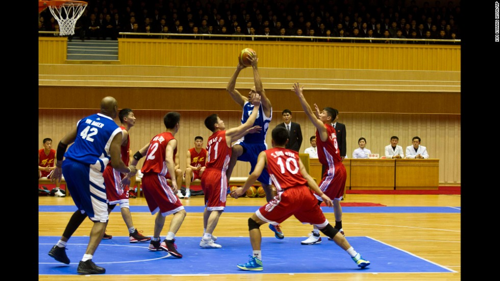 Former NBA star Doug Christie drives to the basket against North Korean players during the exhibition game.