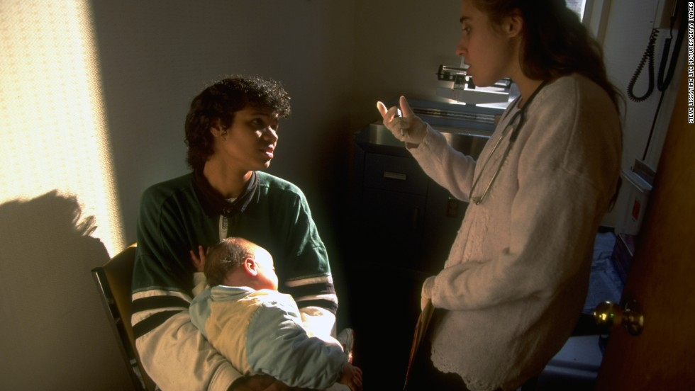 A Medicaid recipient brings her daughter to a hospital in 1995. Medicaid, a federally run health program, was designed to provide coverage for low-income and disabled individuals.