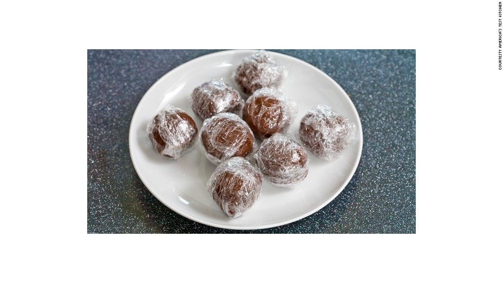 "This recipe makes 10 chocolate balls that can be pulled from the freezer and heated with a cup of milk for delicious ""instant"" hot chocolate. First step: roll, refrigerate, freeze."