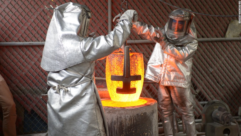 The red-hot crucible is removed from the furnace.